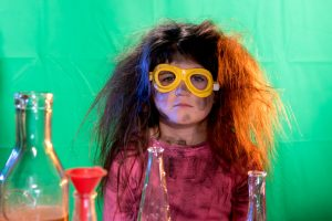 Girl with messy hair science experiment green screen.